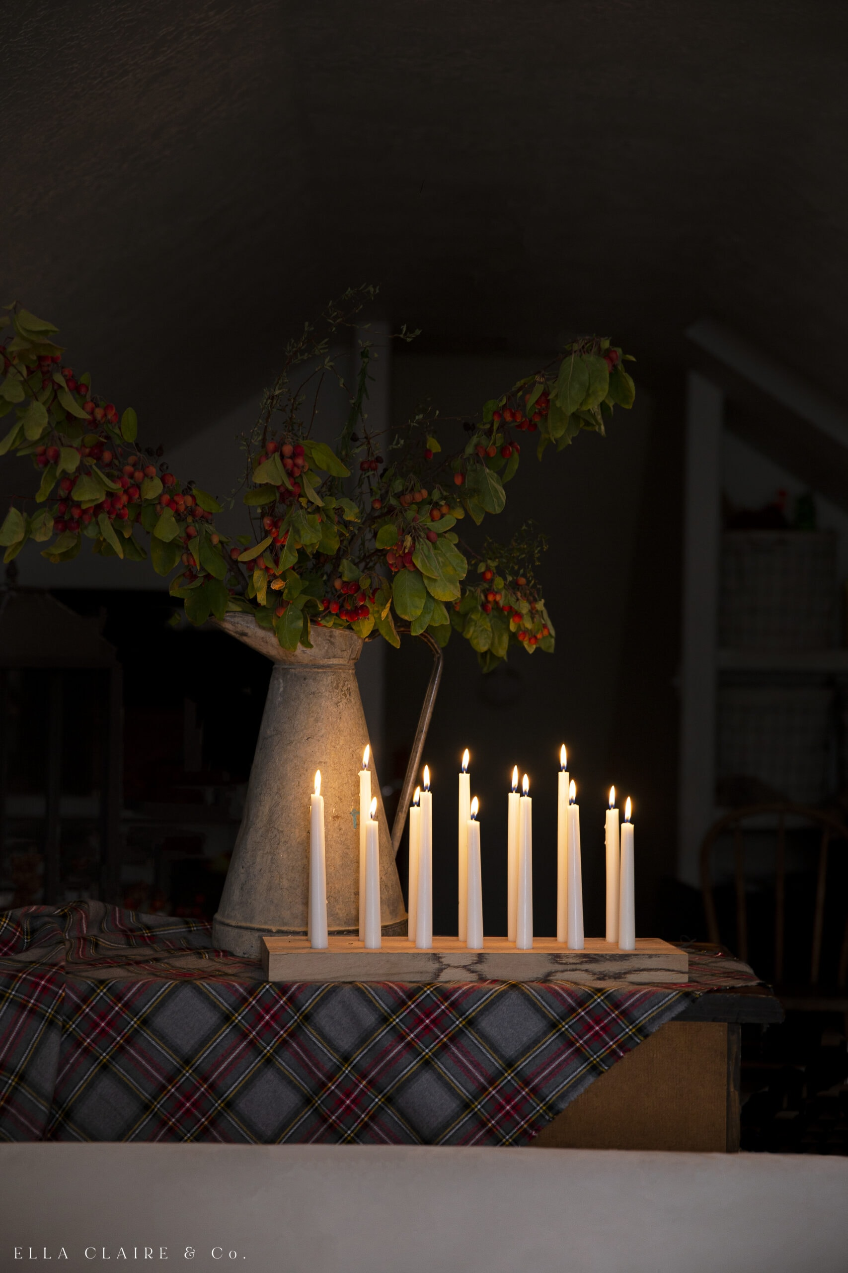 lit candles in holder on table