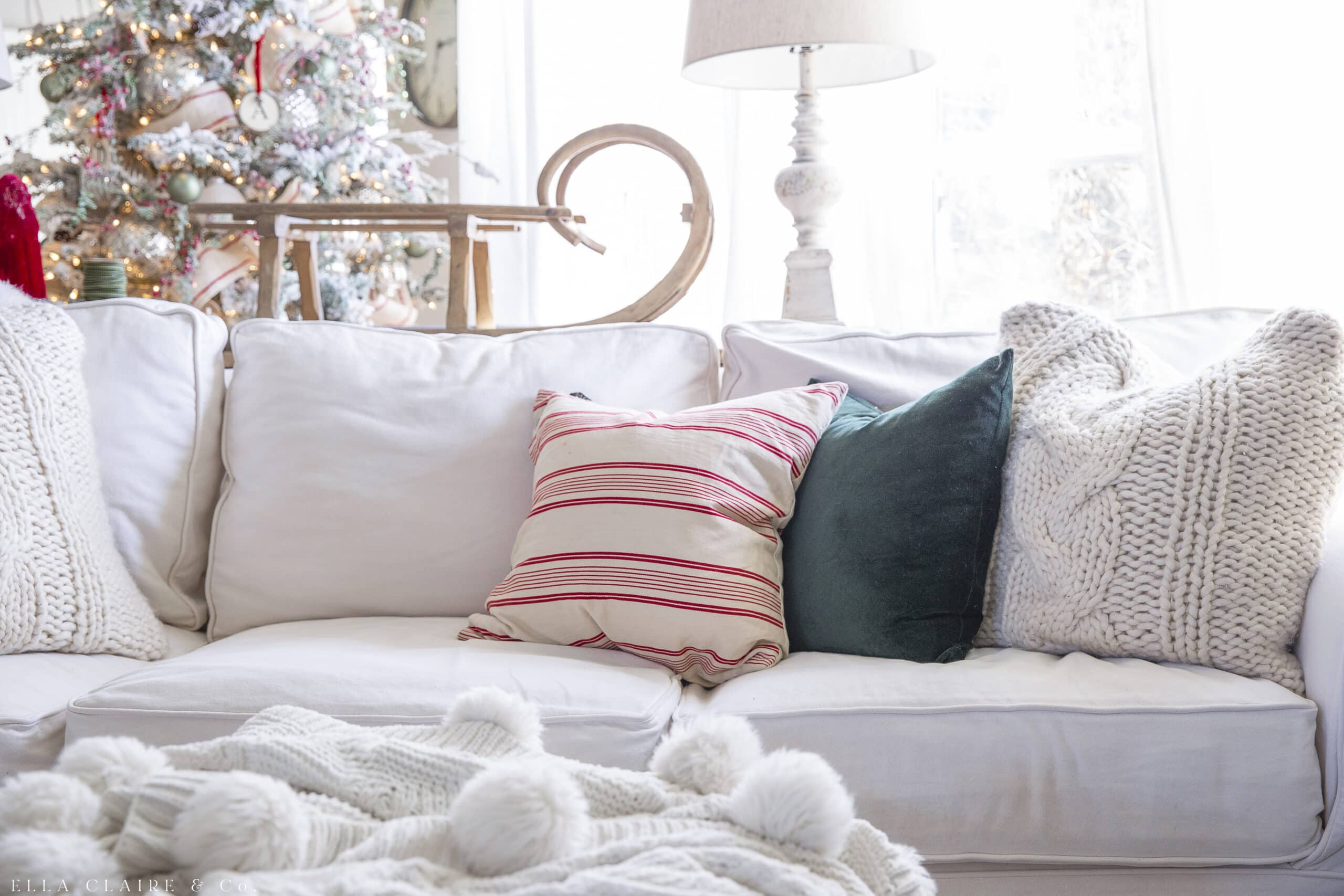 hunter green and red striped pillows with chunky knit pillow