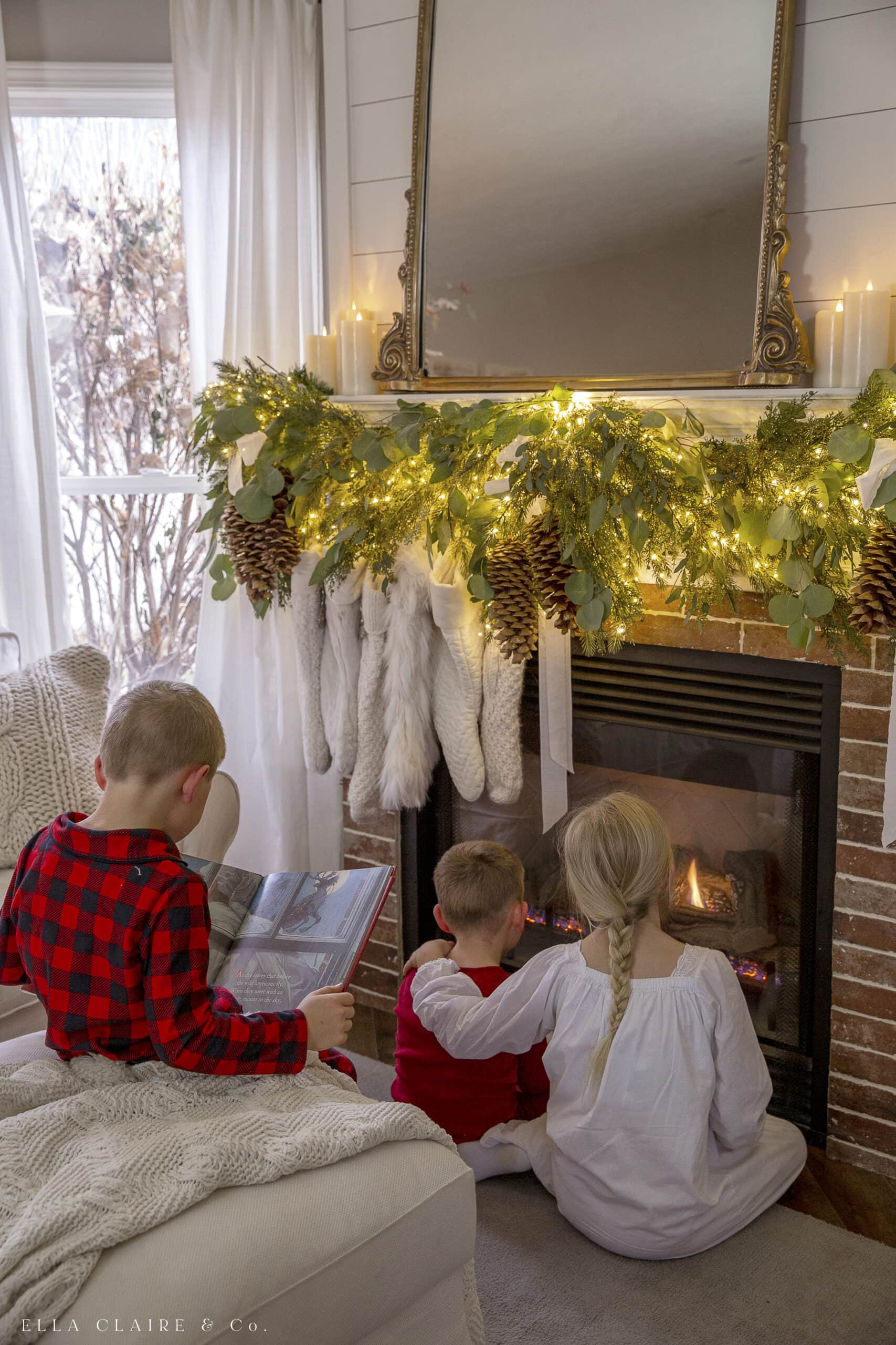 children in pajamas cozying up to the fireplace and reading stories
