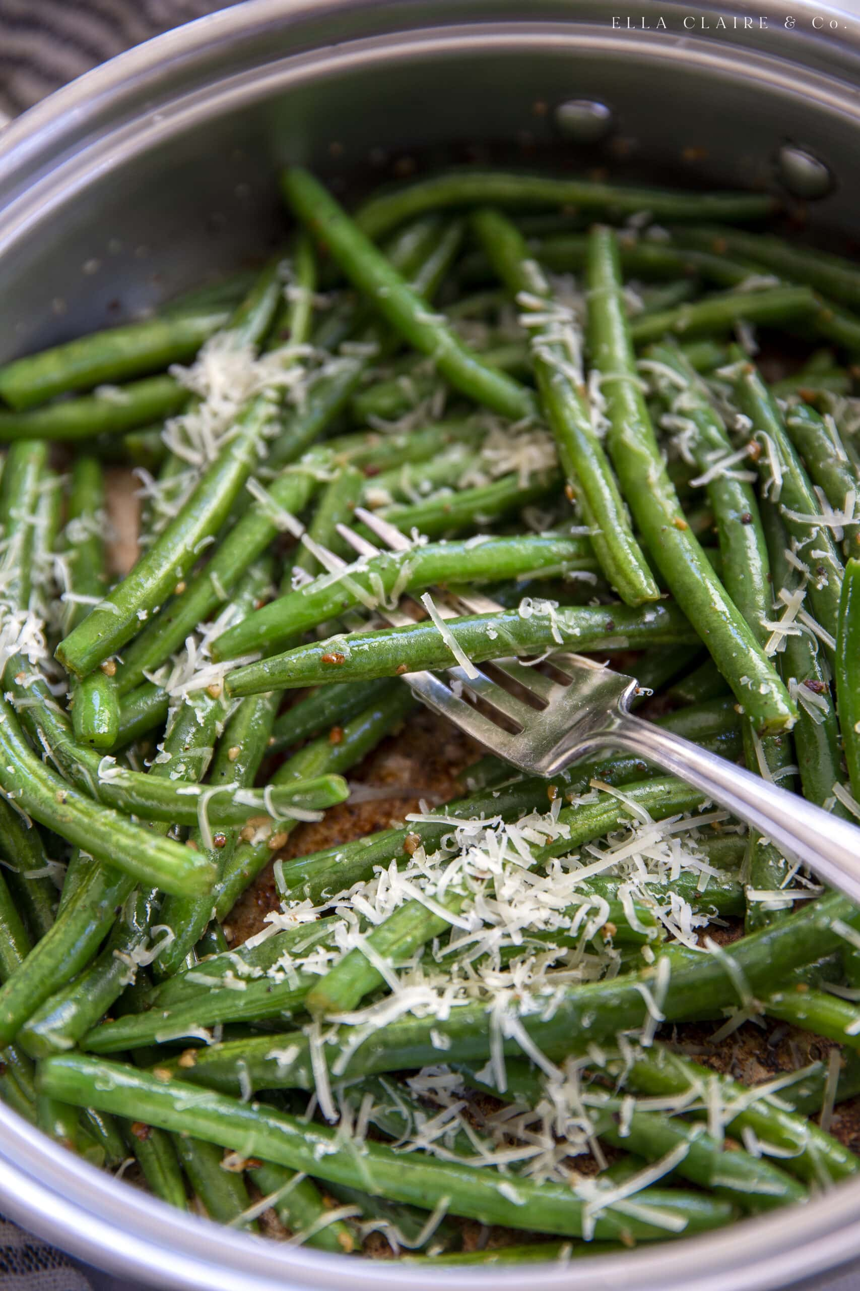 garlic and parmesan on sautéed green beans