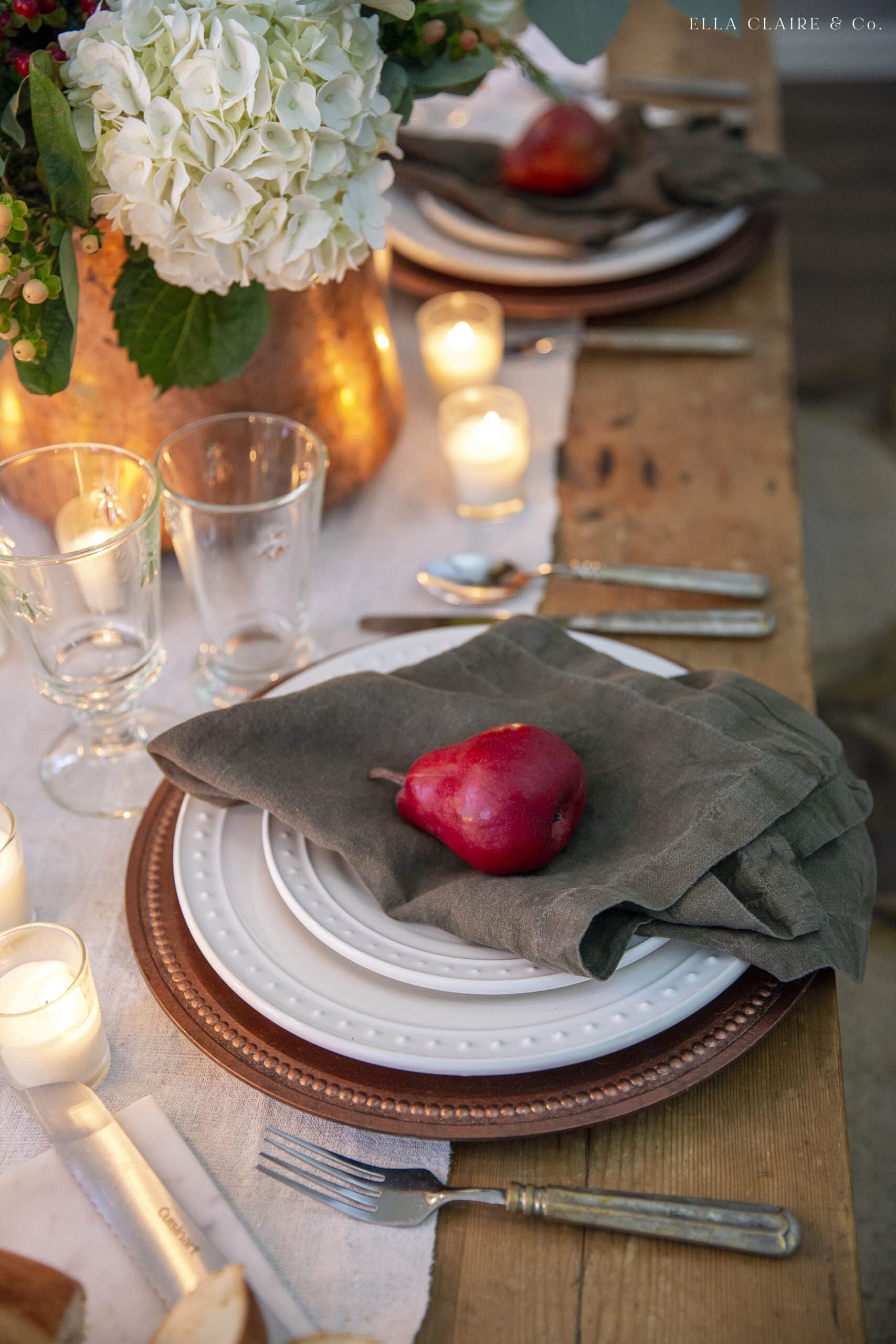 red Christmas pears at table settings
