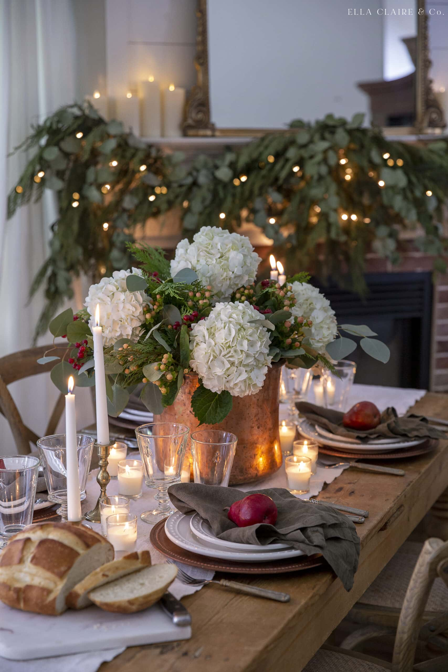 holiday flower arrangement with hydrangeas and berries