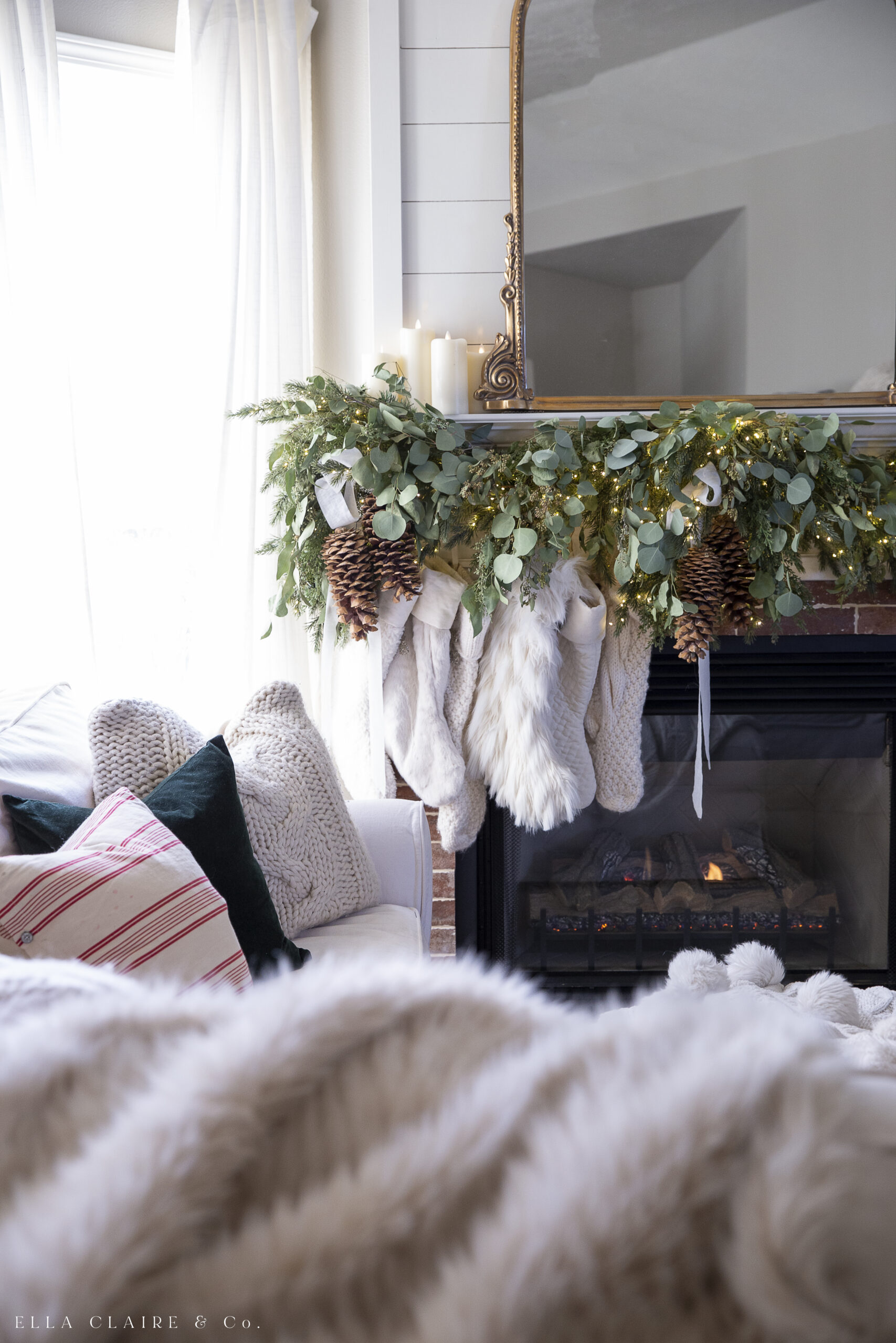 stockings hung on mantel with garland