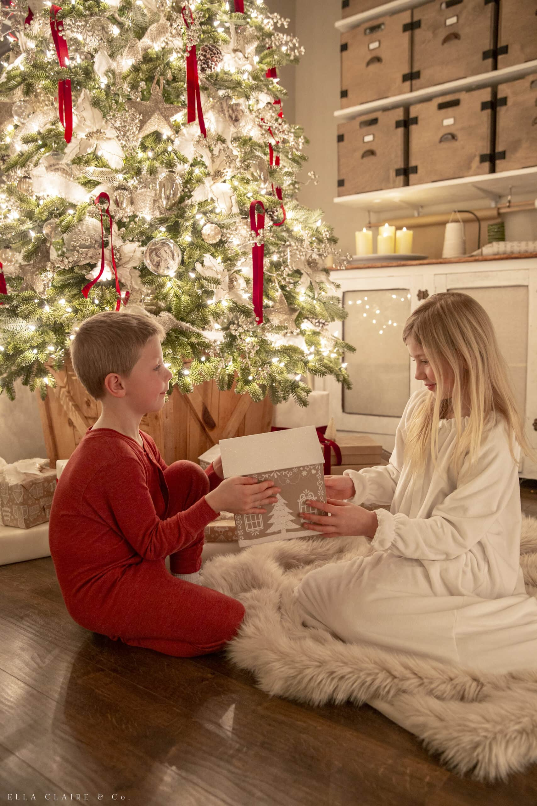 children giving gifts in pajamas