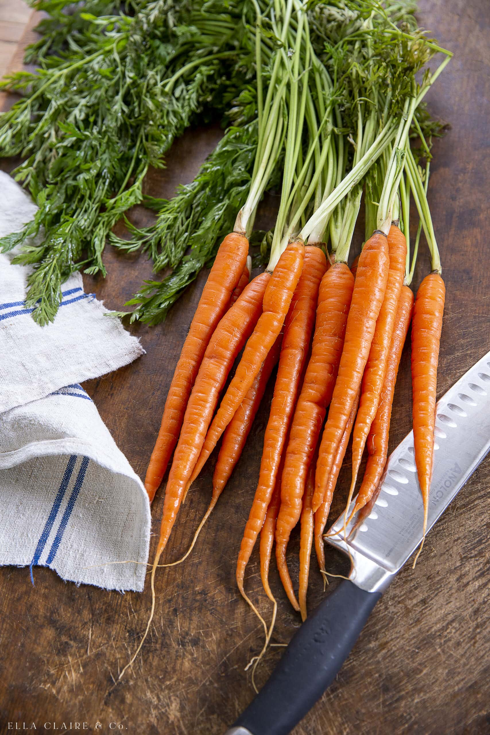 cutting off the tops and ends of carrots