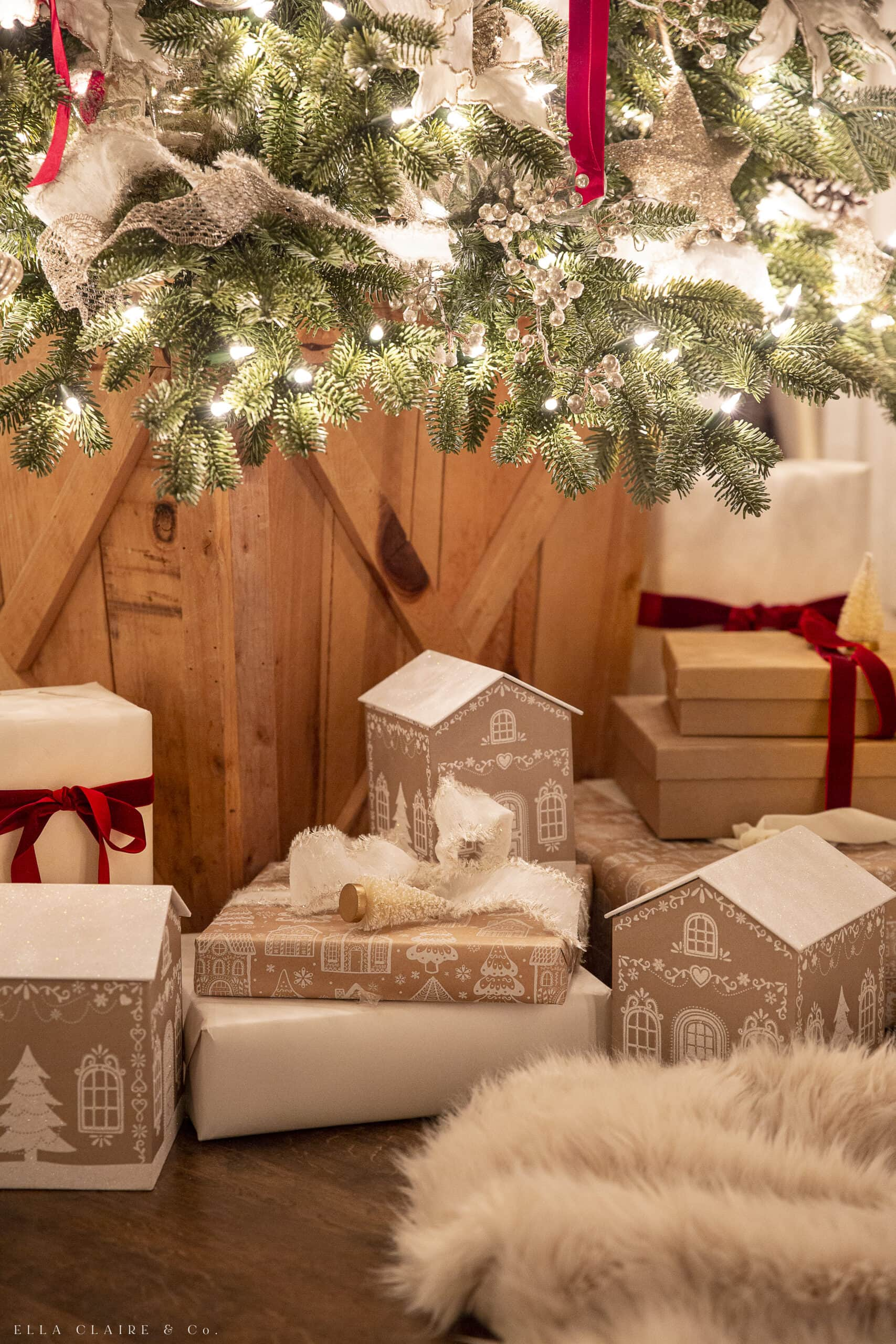 gingerbread gift wrapping and boxes under Christmas tree