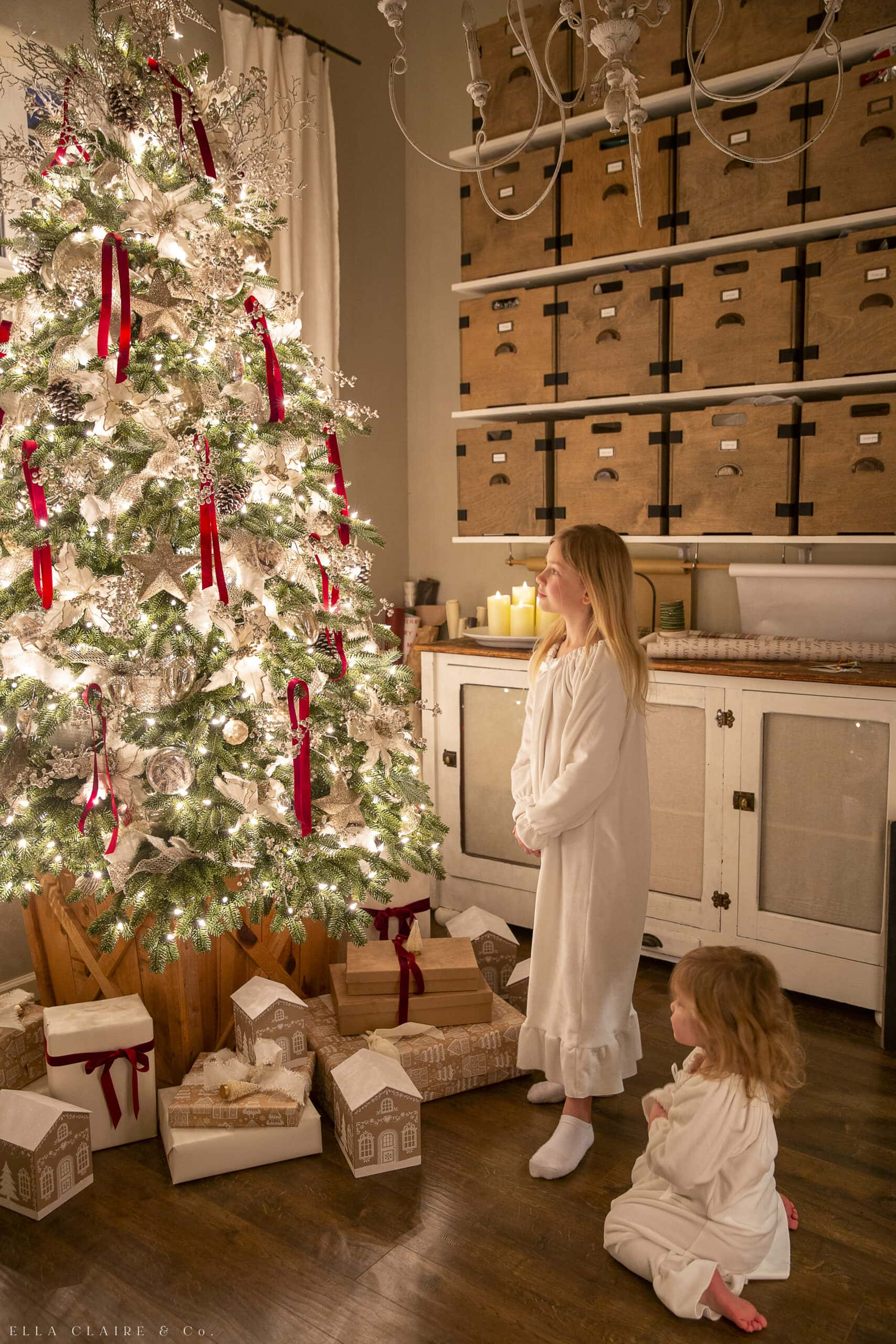 christmas pajamas and looking at the lights of the tree