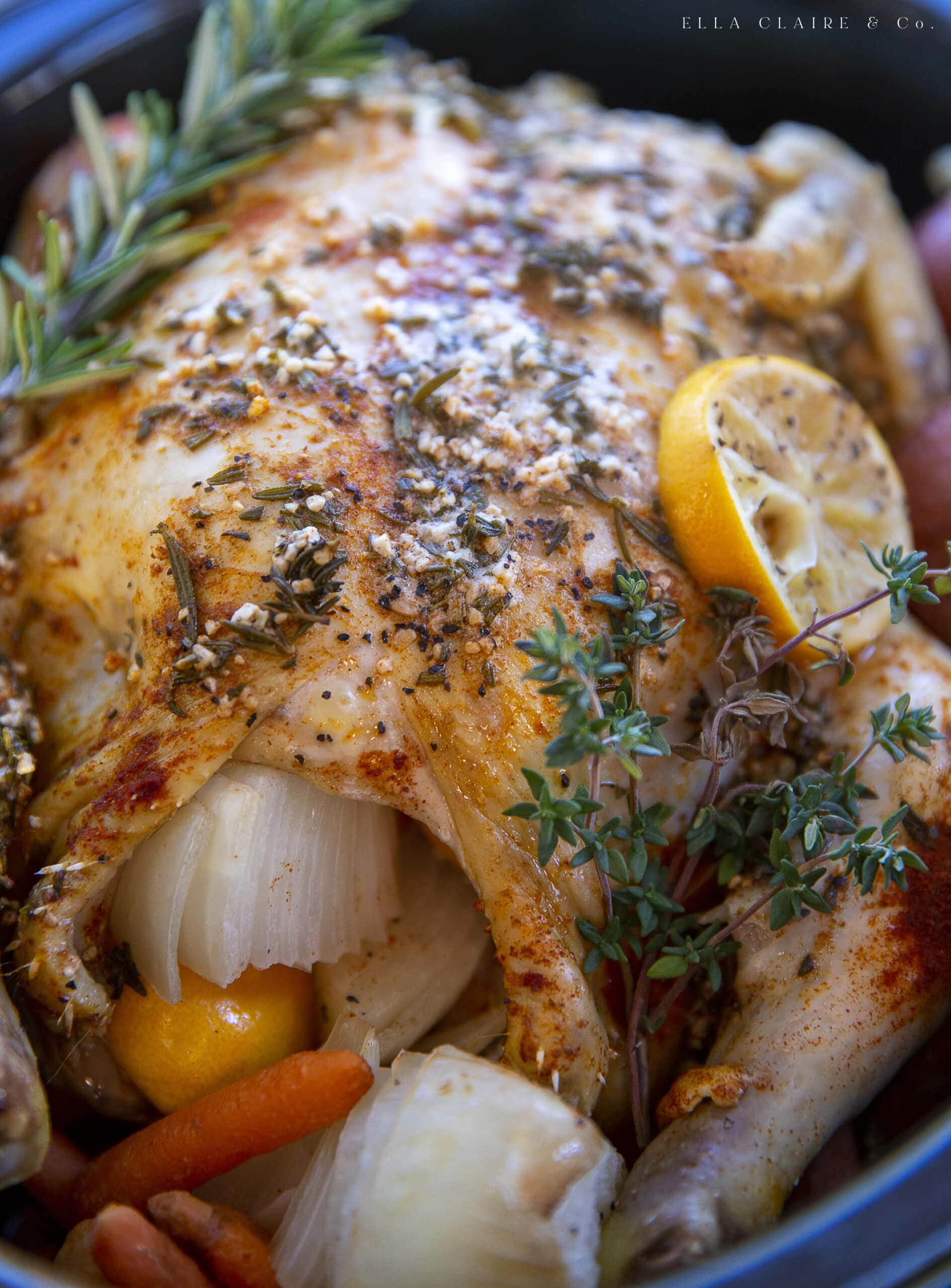 close up of cooked chicken with herbs