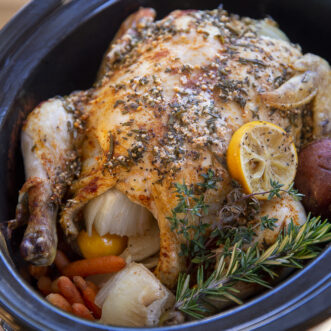 crockpot herb and garlic chicken with potatoes and carrots