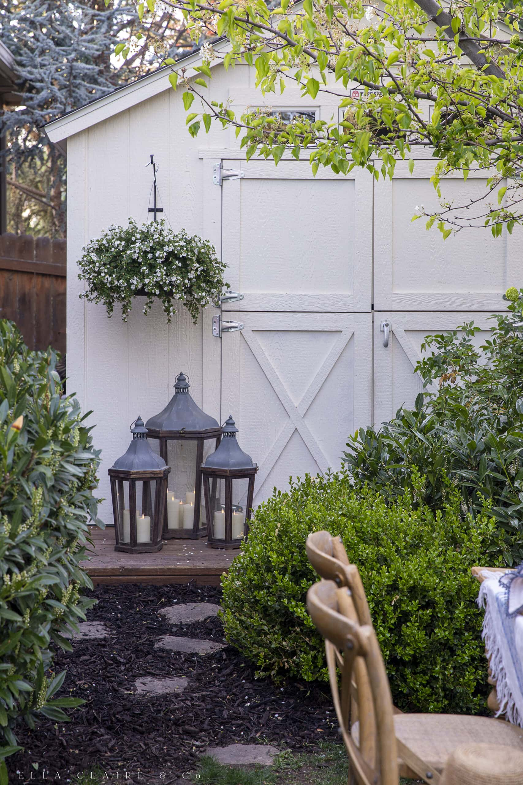 ambiance with lanterns and spring candles for backyard entertaining