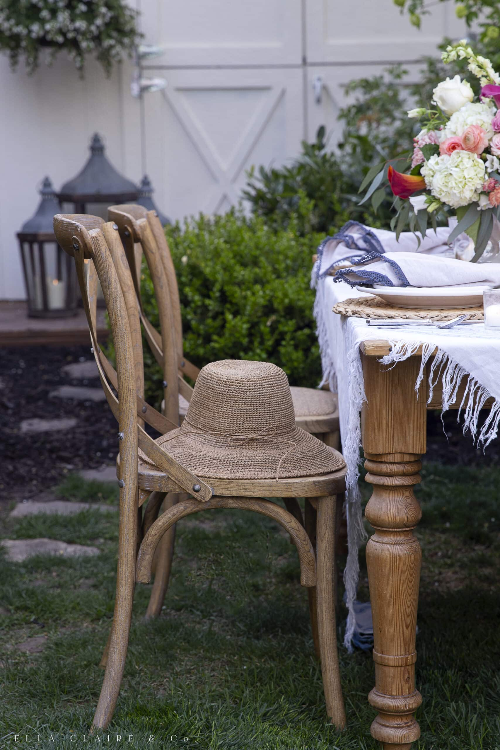 hat on chair next to table set for spring entertaining