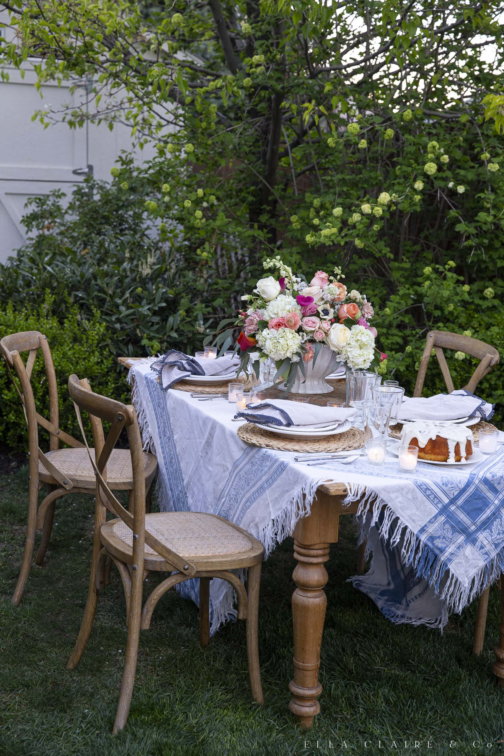 table and chair outdoors decorated for spring dinner