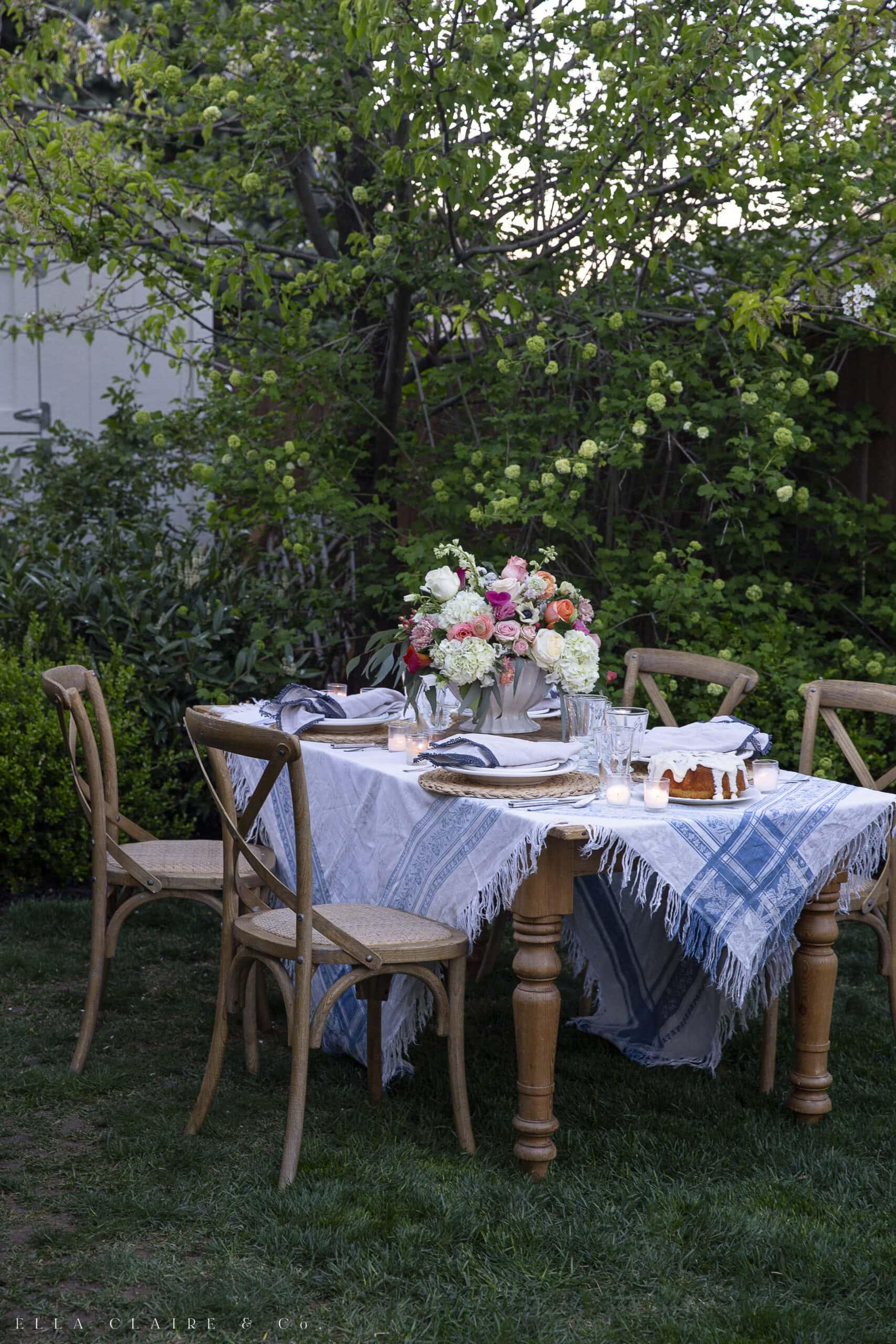 table set up in garden for backyard dinner