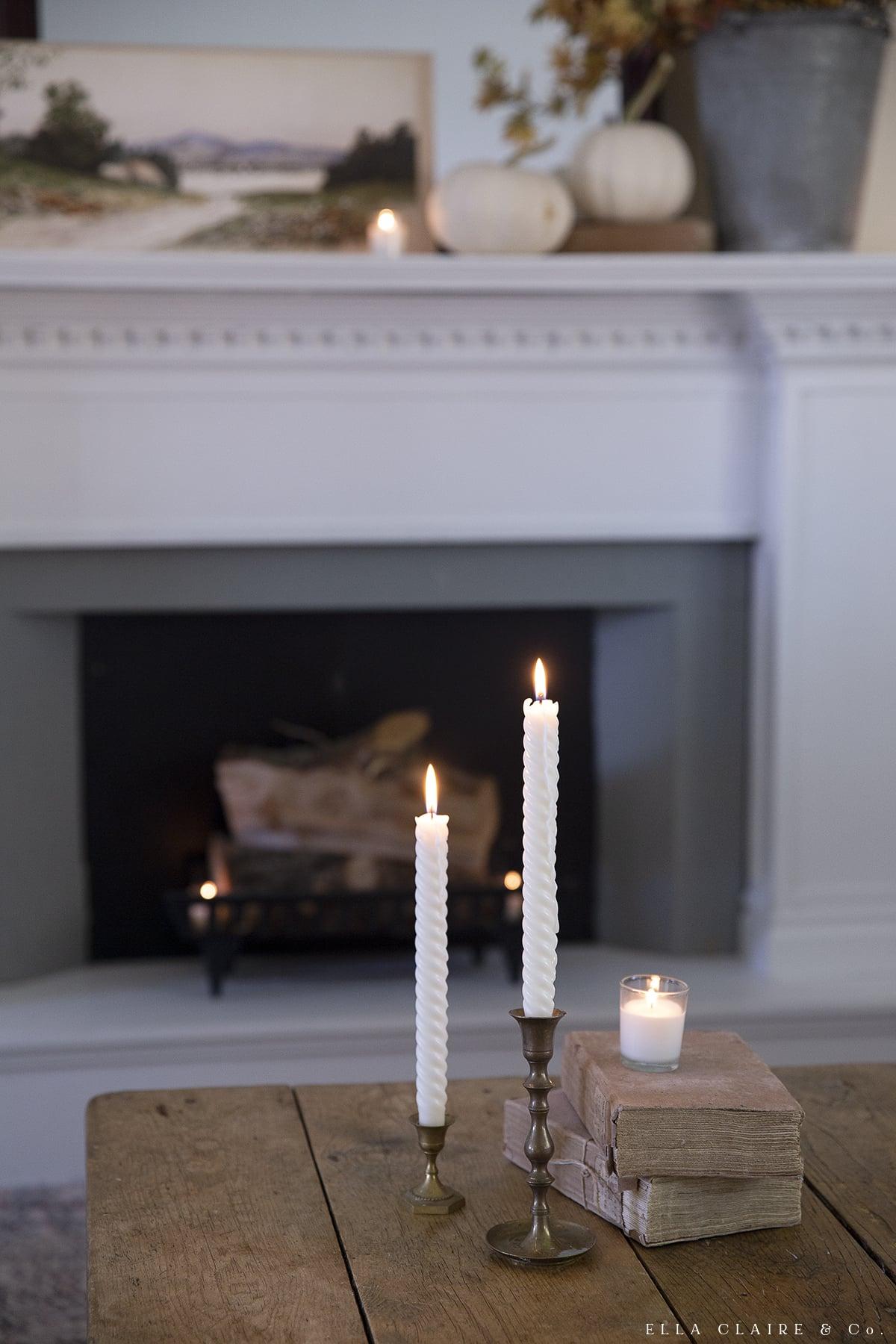candles on brass candlesticks