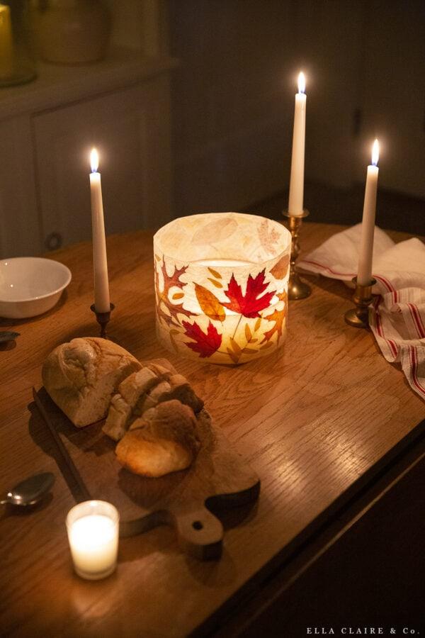 A DIY fall leaf lantern on a simple table